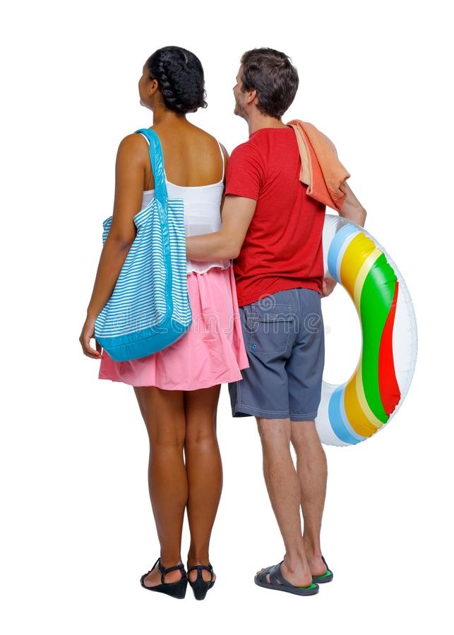 Back view of a an international couple with an inflatable circle stock photo