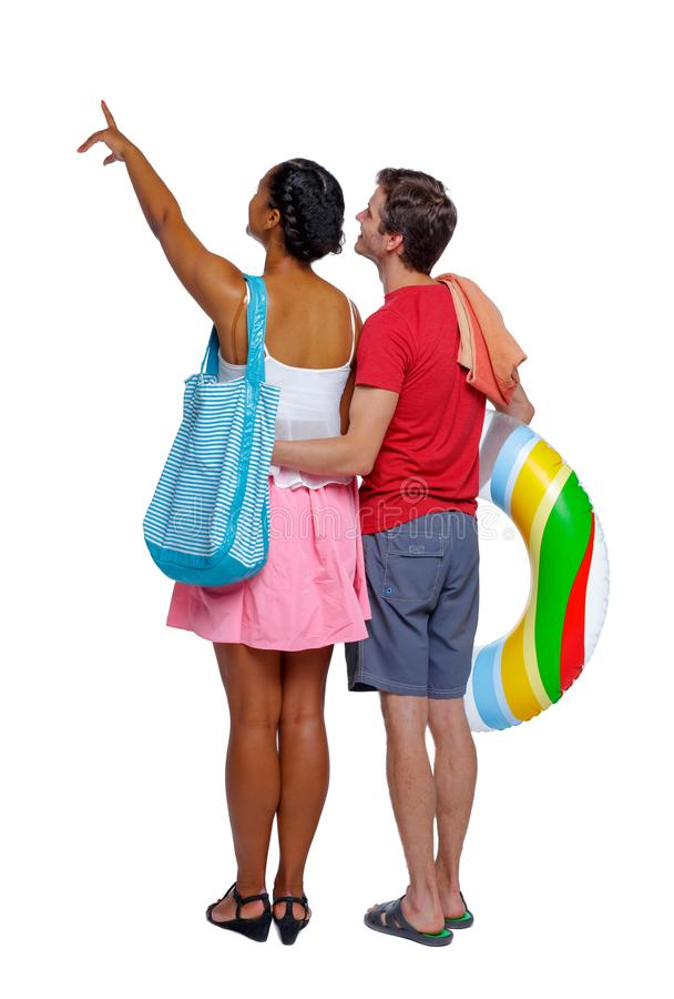Back view of a an international pointing couple with an inflatab royalty free stock photos