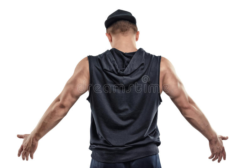 Back view of isolated fitness man posing and shows arm muscles royalty free stock images