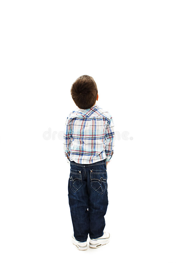 Back view of little boy looking at wall. Rear view royalty free stock photo