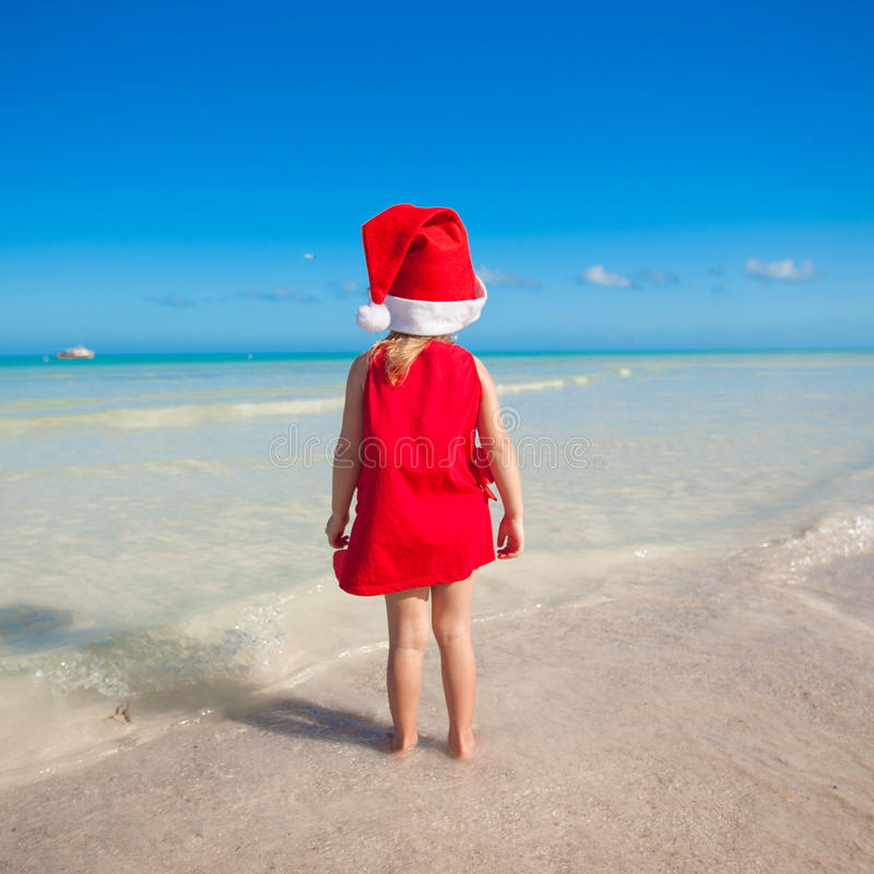 Back View Of Little Cute Girl In Red Hat Santa Royalty