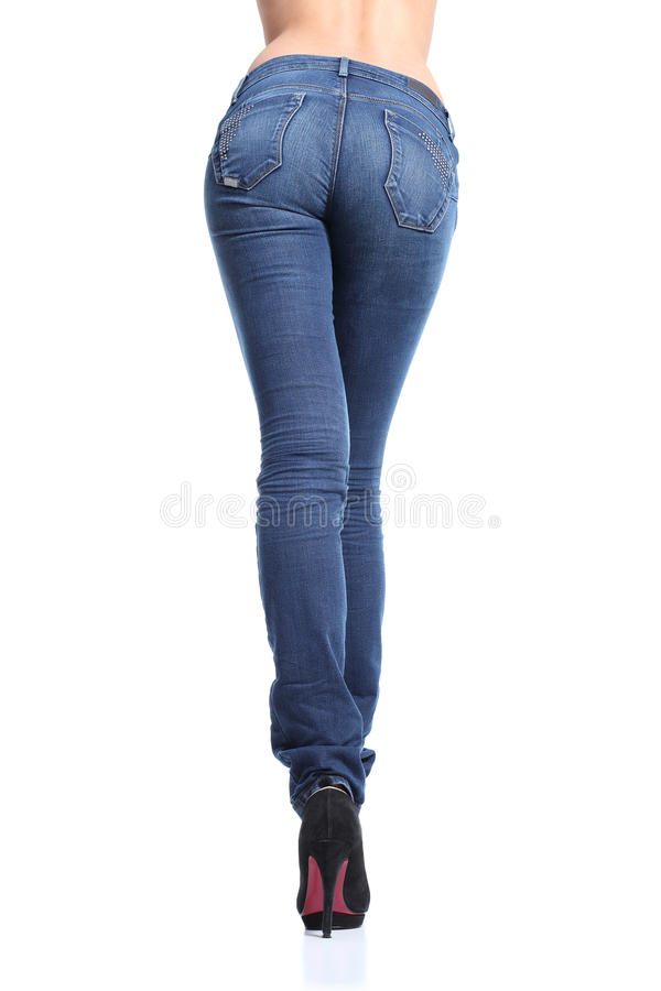 Back view of a long woman legs posing with jeans stock image