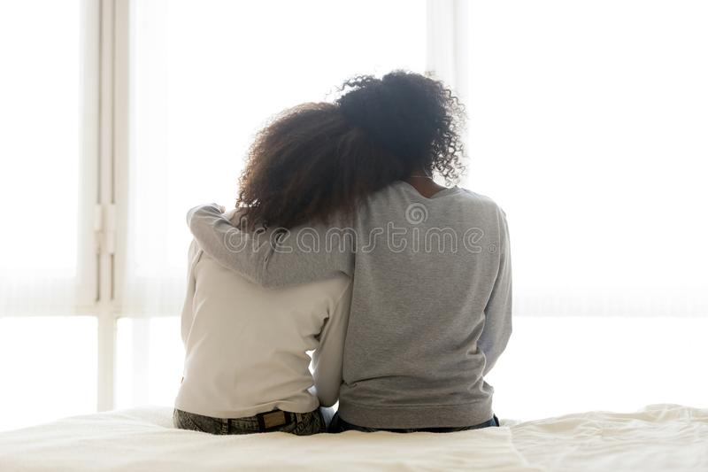 Back view of loving mom hug teen daughter royalty free stock photography