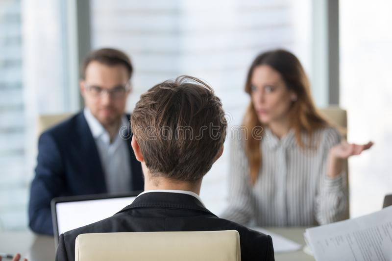 Back view of male CEO negotiating with diverse partners stock photos