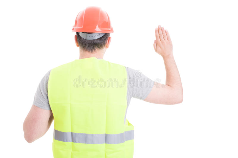 Back view of male constructor standing and doing a vow. As pledge concept isolated on white background stock images