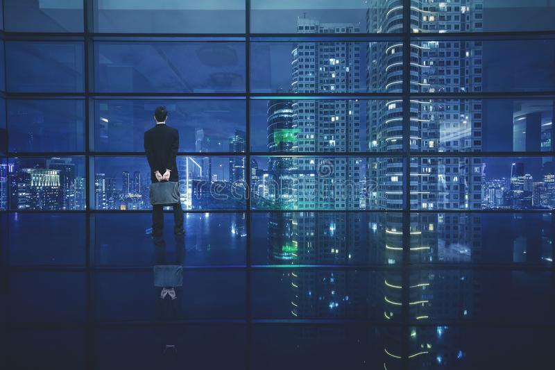 Male manager looking at a city stock images