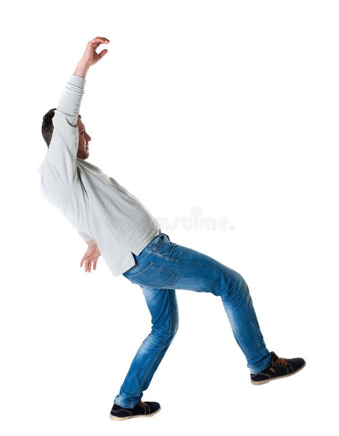 Back view man Balances waving his arms. stock image