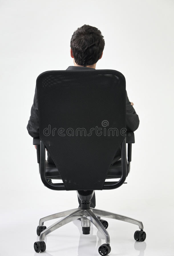 Back view of man on chair royalty free stock photo