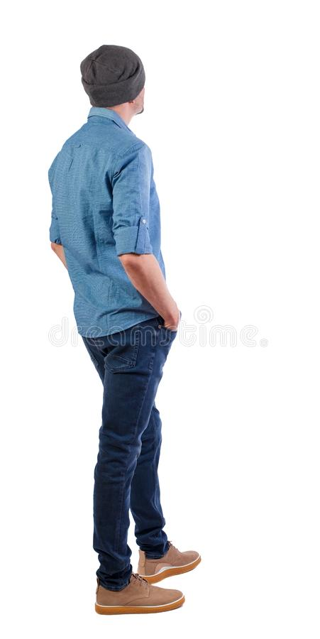 Back view of man in dark jeans. Standing young guy. Rear view people collection. backside view of person. Isolated over white stock images