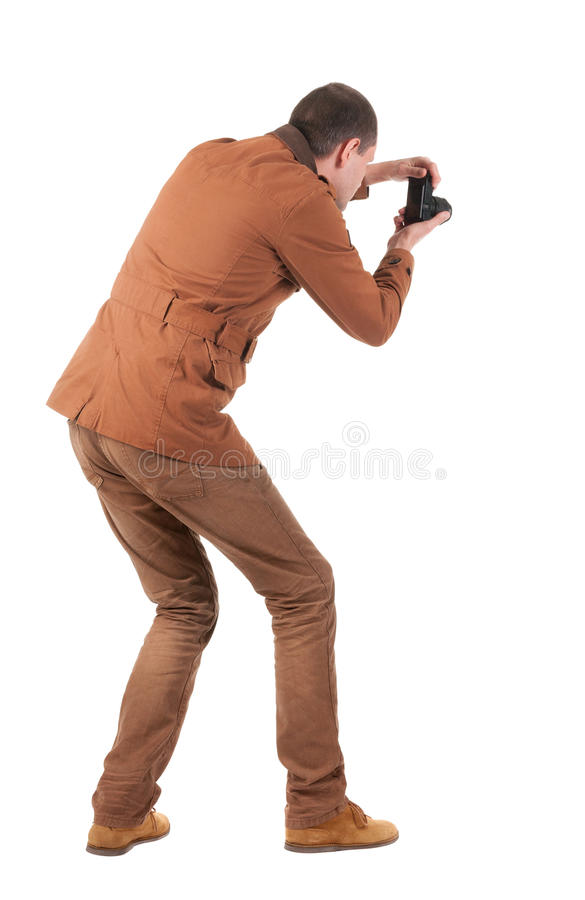 Back view of man photographing stock photos