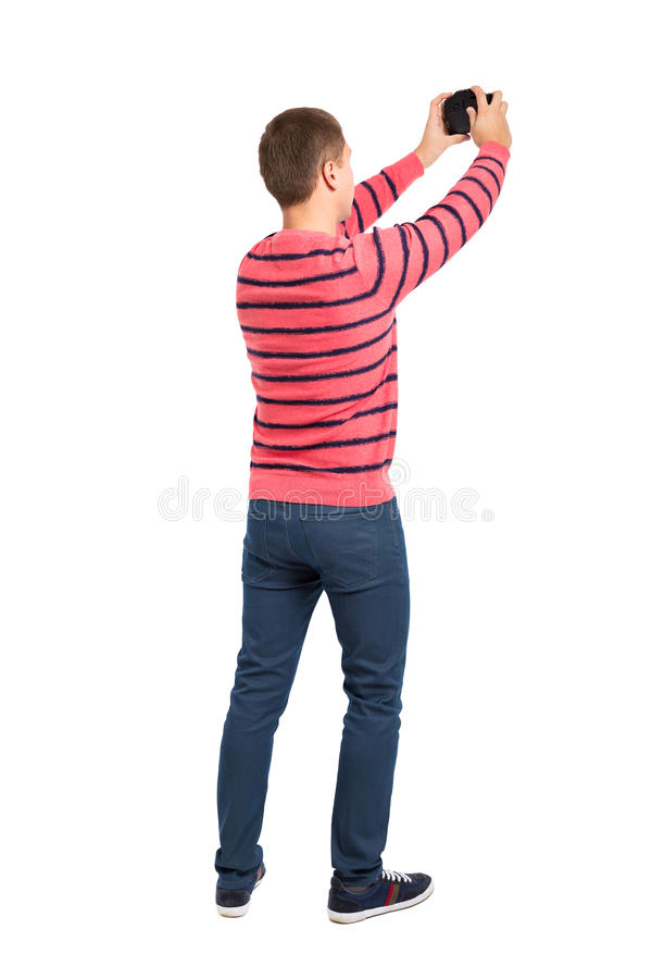 Back view of man photographing royalty free stock images
