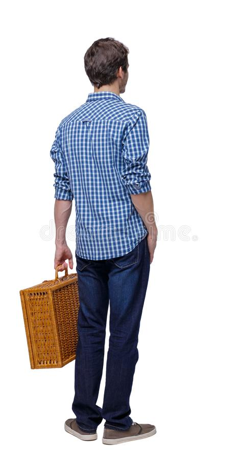 Back view of a man walking with a picnic bag stock photos