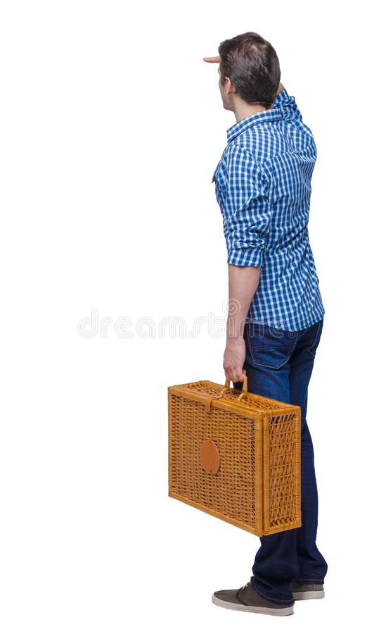 Back view of a man walking with a picnic bag stock photo