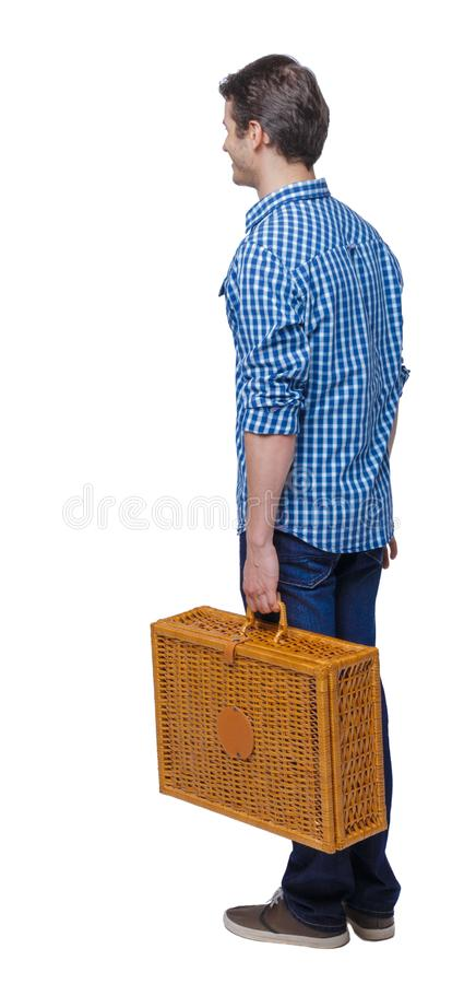 Back view of a man walking with a picnic bag royalty free stock photography
