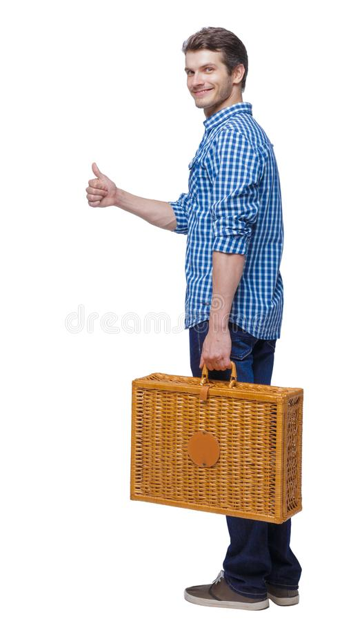 Back view of a man walking with a picnic bag showing thumb up stock image