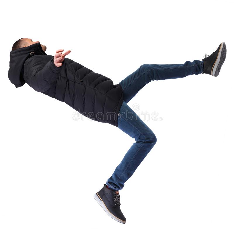 Back view man in winter jacket Balances waving his arms. Rear view people collection. backside view of person. Isolated over white background. The guy in a stock photo