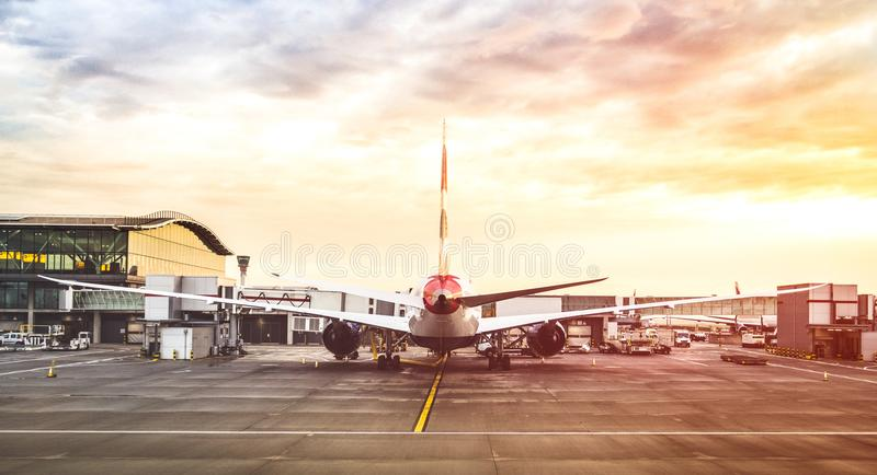 Back view of modern airplane at terminal gate ready for takeoff stock images