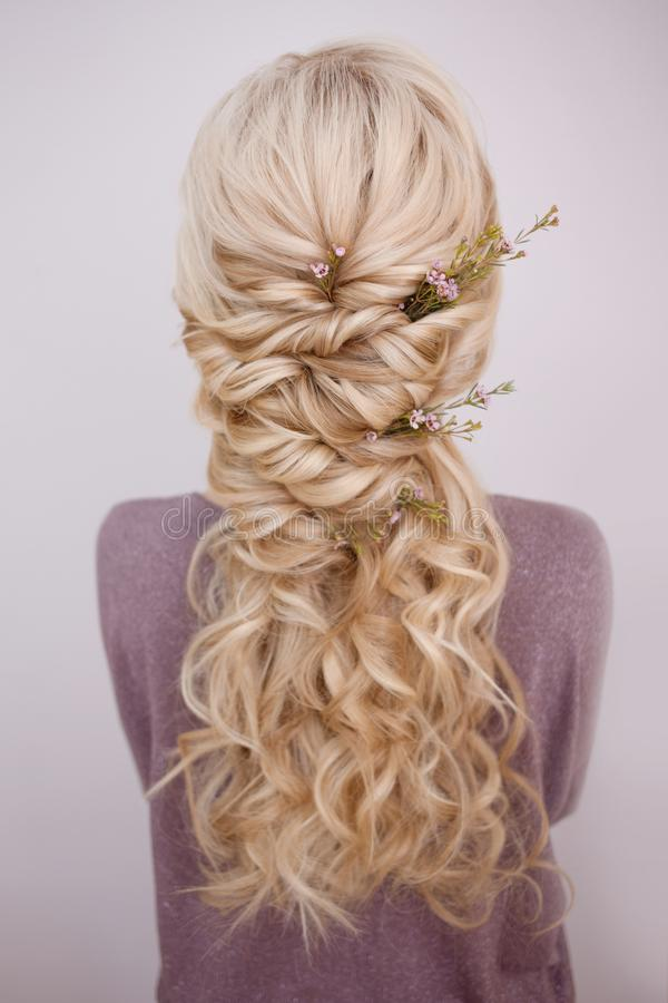 Free Back View Of An Elegant Trendy Hairstyle, Interlacing Curls And Decorating With Flower Petals Royalty Free Stock Photography - 133503767