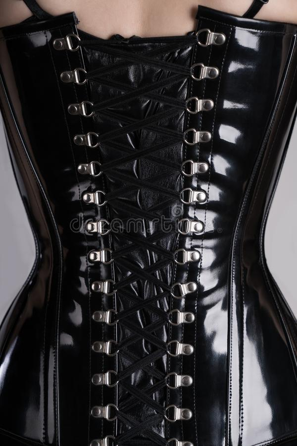 Free Back View Of Fetish Woman In Black Corset Stock Photo - 107379860