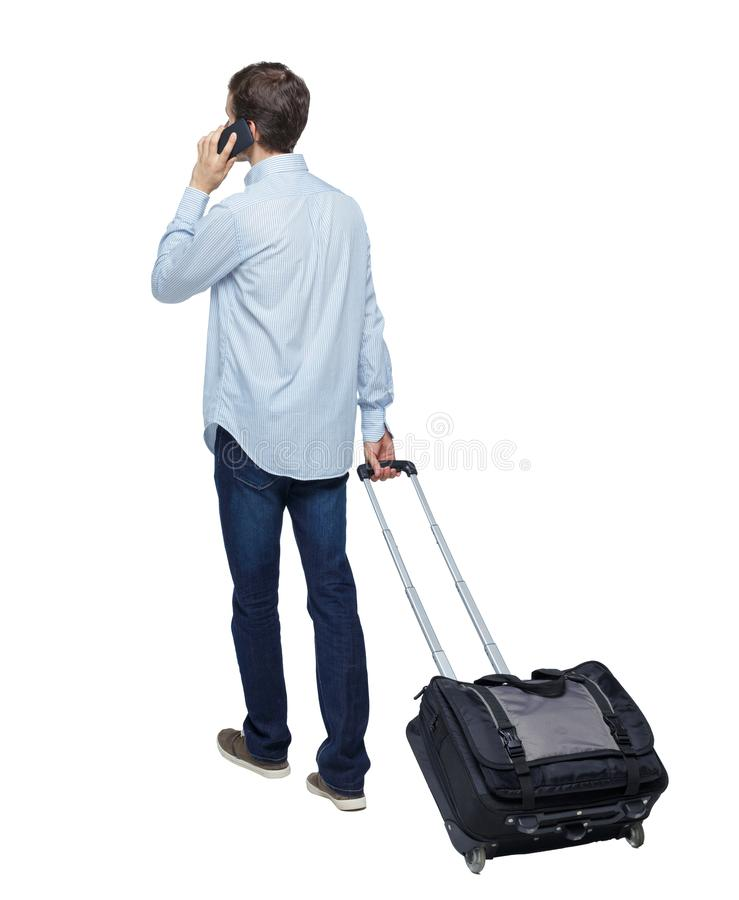 Free Back View Of Walking Business Man With Suitcase Talking On The Phone Stock Images - 157002534