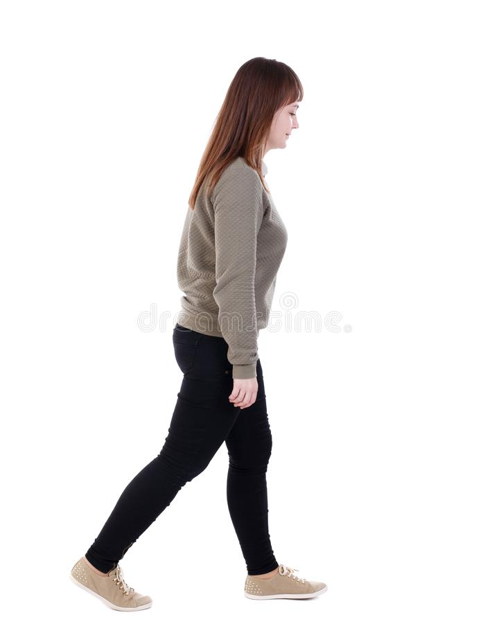 Free Back View Of Walking Woman. Beautiful Blonde Girl In Motion. Stock Photo - 76504520
