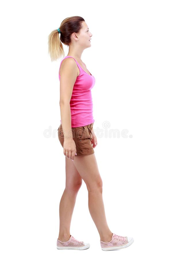 Free Back View Of Walking Woman. Beautiful Blonde Girl In Motion. Royalty Free Stock Image - 76777916