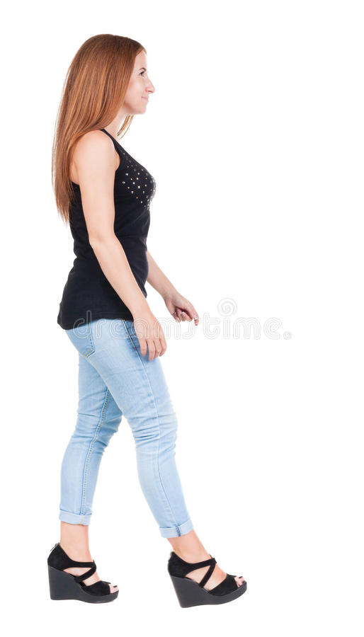 Free Back View Of Walking Woman. Beautiful Redhead Girl In Motion. Stock Photography - 51772972
