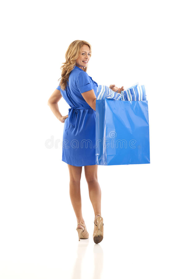 Free Back View Of Woman Holding Shopping Bag Stock Photos - 16897673