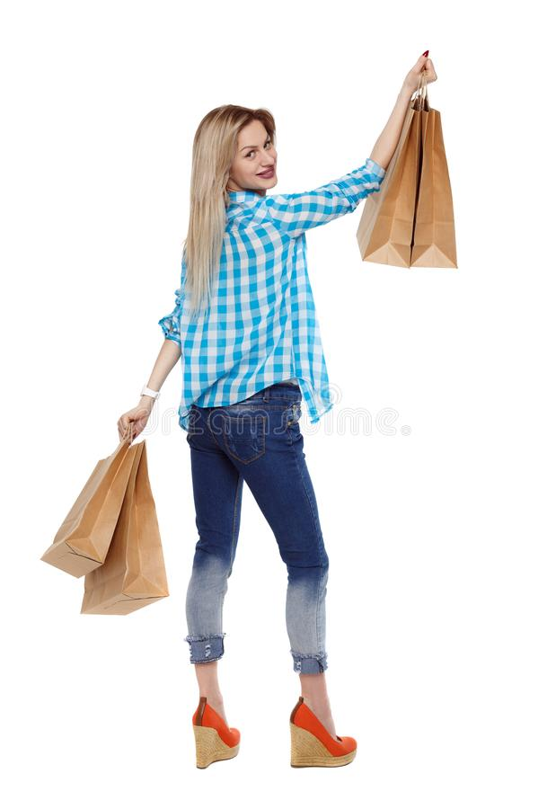 Free Back View Of Woman With Shopping Bags . Stock Photos - 116401503