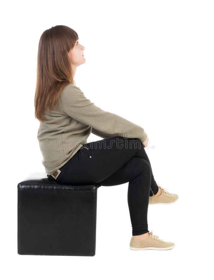 Free Back View Of Young Beautiful Woman Sitting. Royalty Free Stock Images - 65012209