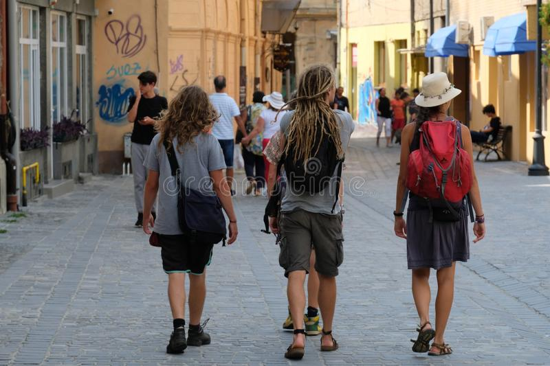 Young tourists walking on a street of Brasov, Romania royalty free stock photos