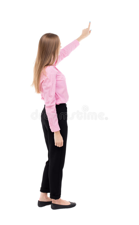 Back view of pointing business woman. Back view of pointing woman. beautiful girl. Rear view people collection. backside view of person. Isolated over white royalty free stock photo