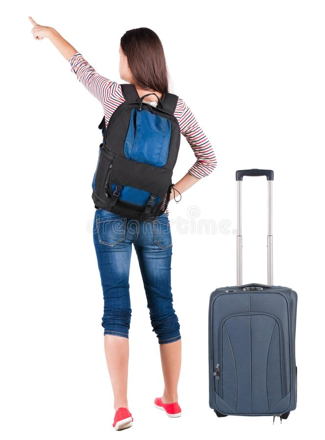 Back view of pointing woman with backpack looking up. Standing young girl. Rear view people collection. backside view of person. Isolated over white background stock photos