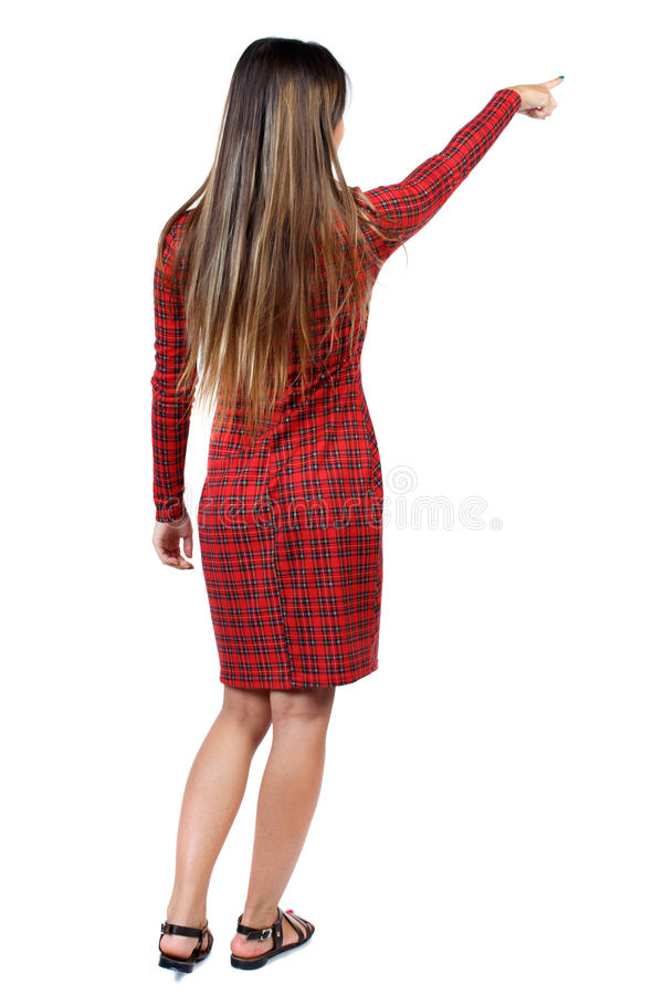 Back view of pointing woman. beautiful girl. stock photo