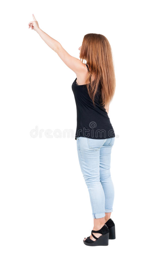 Download Back View Of  Pointing Woman. Beautiful Redhead Girl In Jeans. Stock Image - Image: 45045827
