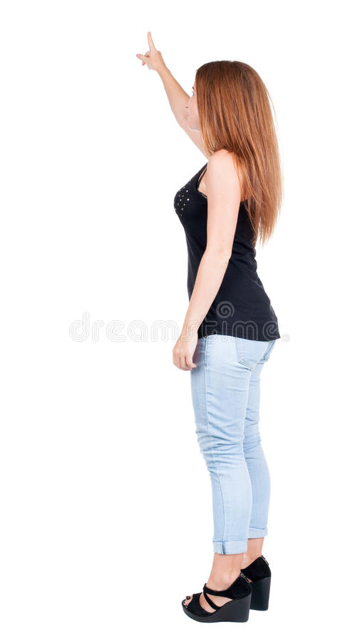 Back view of pointing woman. redhead girl teaches. stock image