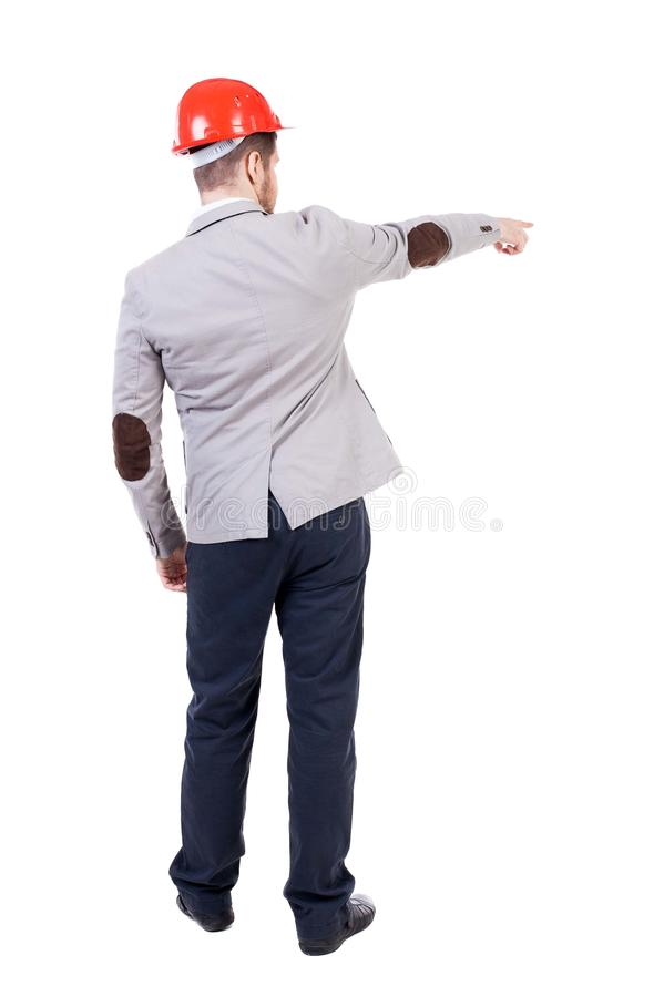 Back view of pointing young men in helmet. royalty free stock image