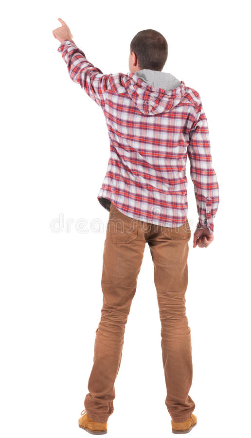 Back view of pointing young men in plaid shirt with hood royalty free stock images