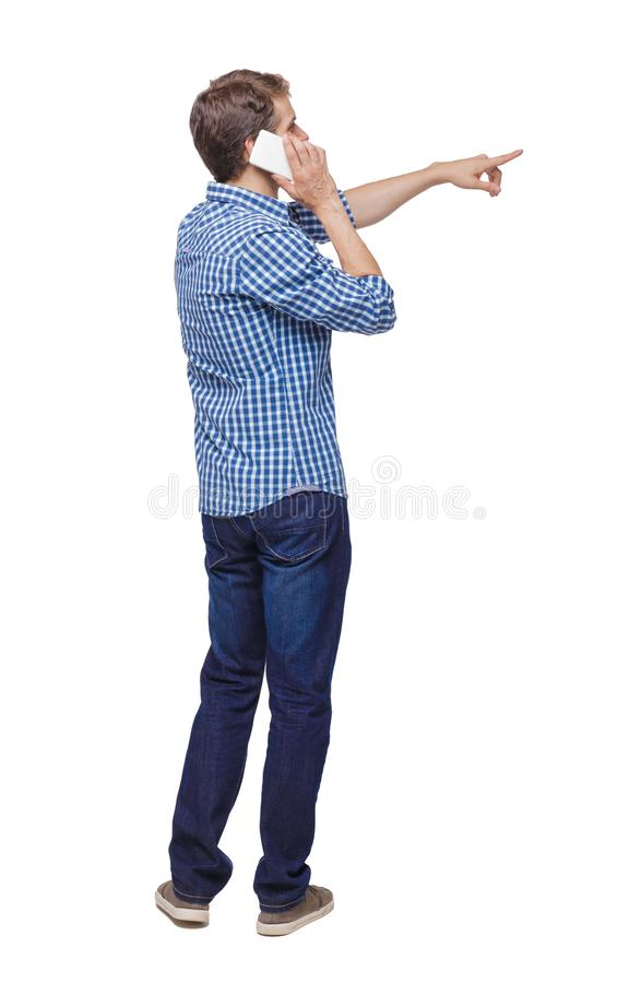 Back view of pointing young men talking on cell phone. Back view of pointing young man talking on cell phone. Young guy gesture. Rear view people collection stock image