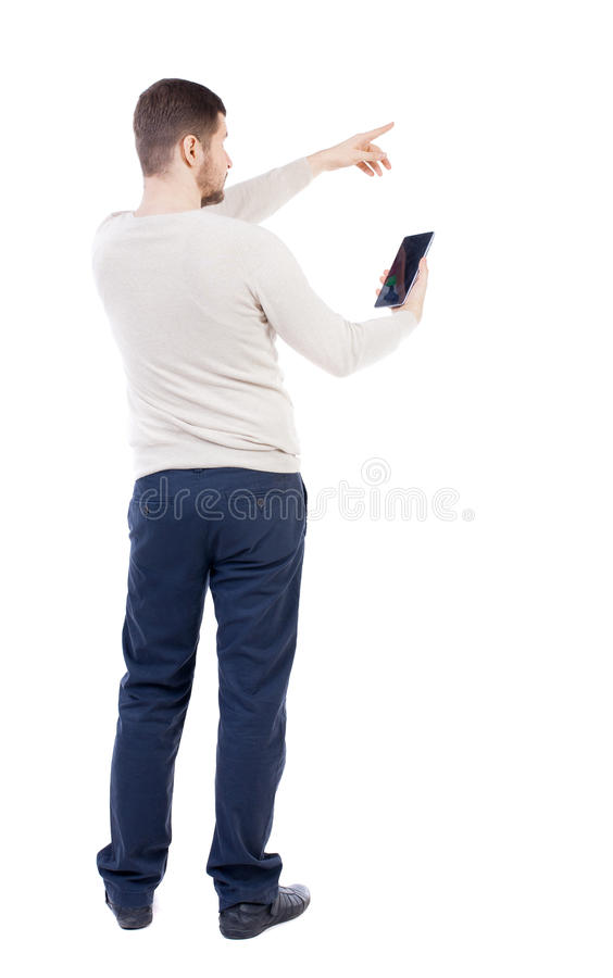 Back view of pointing young men talking on cell phone. stock photos