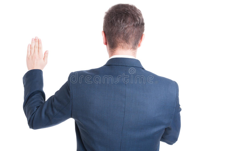 Back view of politician standing raising hand taking oath. Back view of business man or politician standing raising hand taking oath isolated on white background royalty free stock image