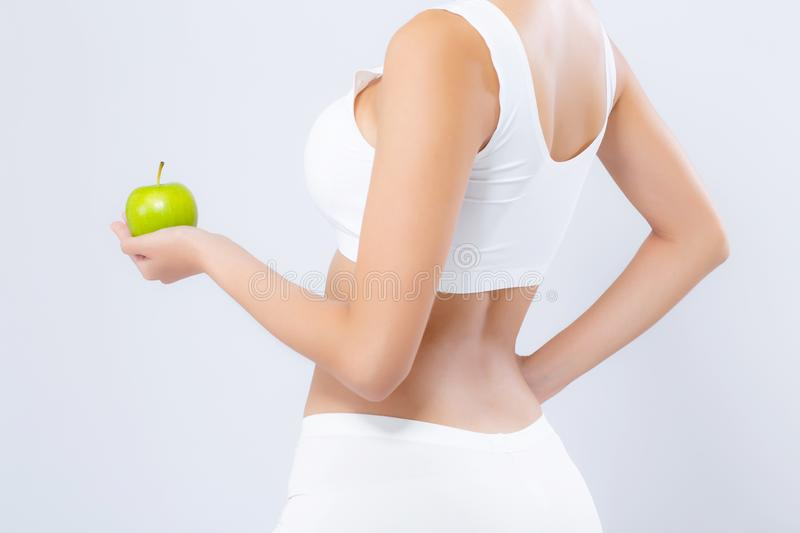 Back view portrait asian woman holding green apple fruit and beautiful body diet with fit isolated on white background, girl royalty free stock image