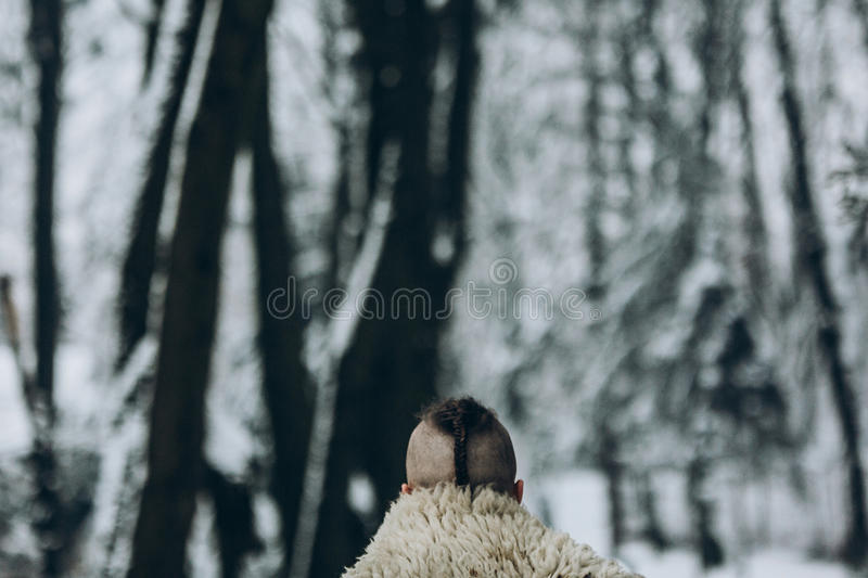 Back view Portrait of strong viking warrior with mohawk haircut stock photos