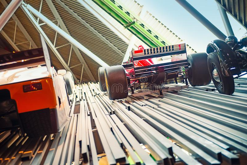Back view racing cars expositions on metal construction. Go ahead, progress concept. Selective focus, copy space stock photography