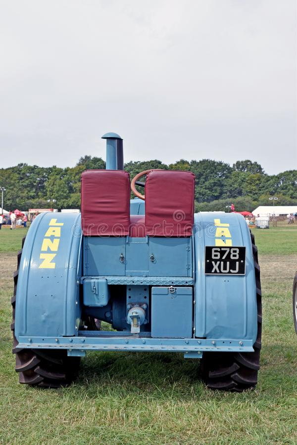 Back view of a retro light blue tractor with two seats stock image