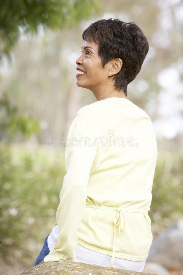 Download Back View Of Senior Woman Outdoors Stock Image - Image: 12405641