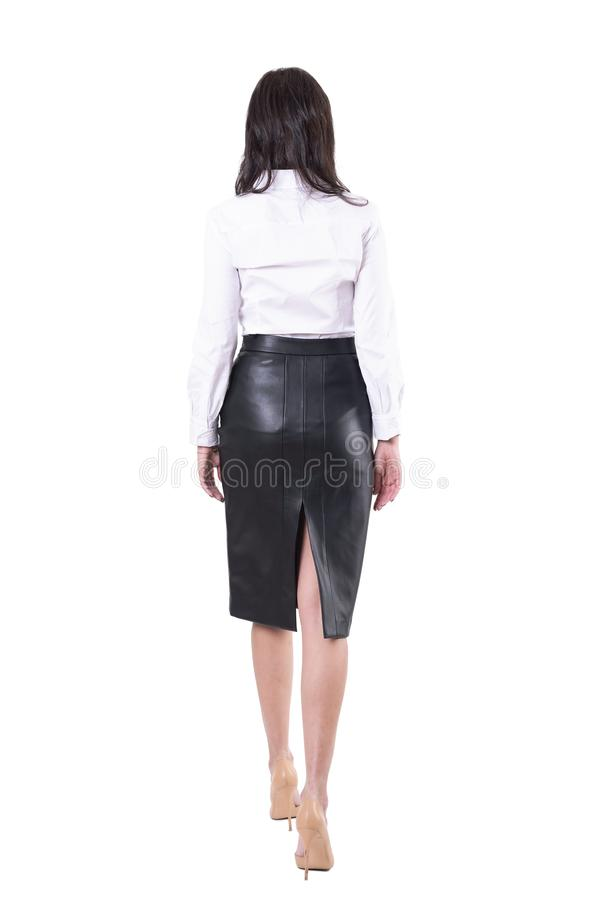 Back view of sexy elegant business woman walking away or leaving. Unrecognizable person. royalty free stock photography