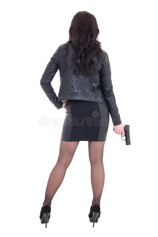 Back view of woman in black holding gun isolated on white stock images