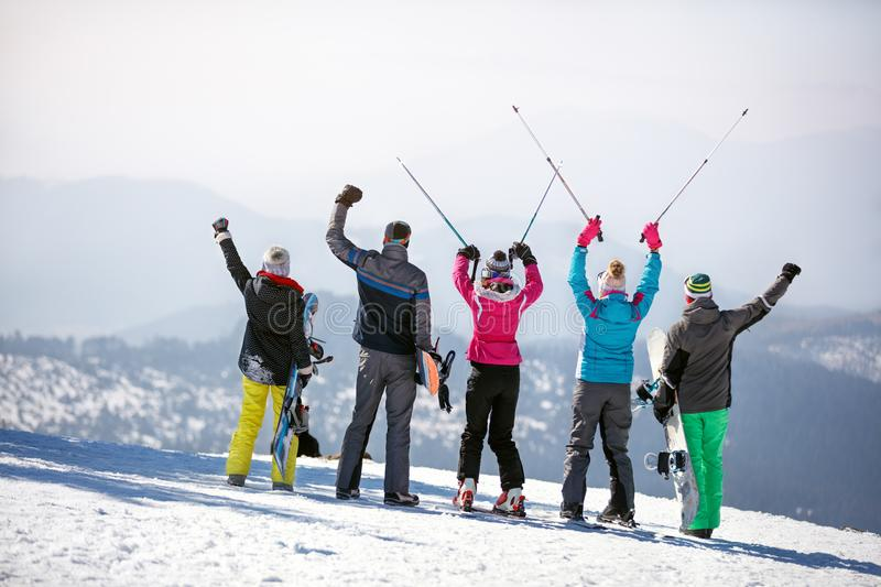 Back view of skiers in mountain stock photo