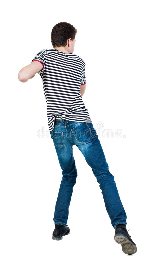 Back view of skinny guy funny fights waving his arms and legs. Isolated over white background. Rear view people collection. backside view of person. Funny guy royalty free stock image